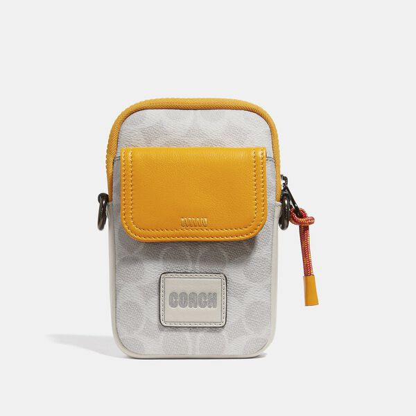 Pacer Convertible Pouch In Colorblock Signature Canvas With Coach Patch, CHALK/POLLEN, hi-res